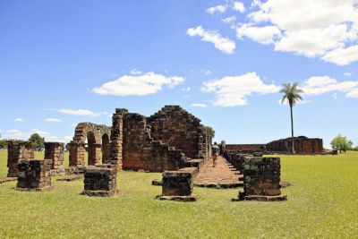 La Santisima Trinidad de Paraná and Ruinas Jesuiticas de Jesús de Tavarangué The gnarled ruins of Jesuit colonies built by missionaries in the 17th century are perhaps Paraguay's most visited spots. These two UNESCO World Heritage sites in Encarnación reveal the scope of the Jesuits' mission to assimilate the indigenous Guaraní to their religion. After the Guaraní War in 1756, which forced Jesuits out of Spanish lands, the colonies were abandoned and fell into decay. Stay past dusk for the nighttime light show at Trinidad, and check out the smart museum for the history of slavery and colonization in the region.